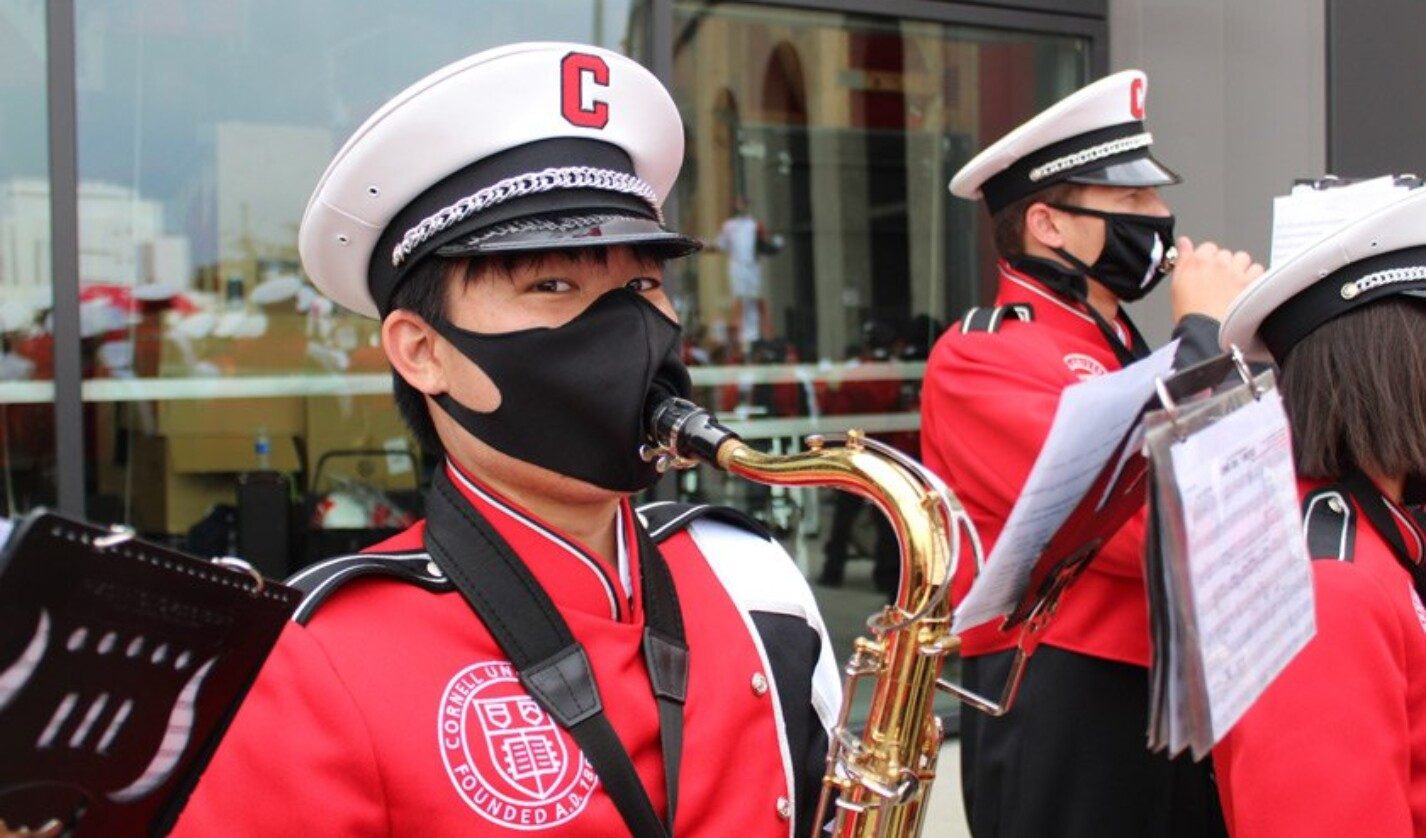 A Big Red Marching Band saxophone player performs outside of Fischell Band Center during Homecoming weekend 2021.