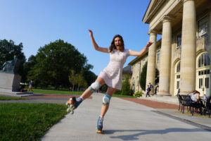"""Ann Maris Walton '22 skating on the Arts Quad: """"I started rolling in fall 2020 when I saw how much fun Clara and Nina were having on their wheels,"""" she says."""