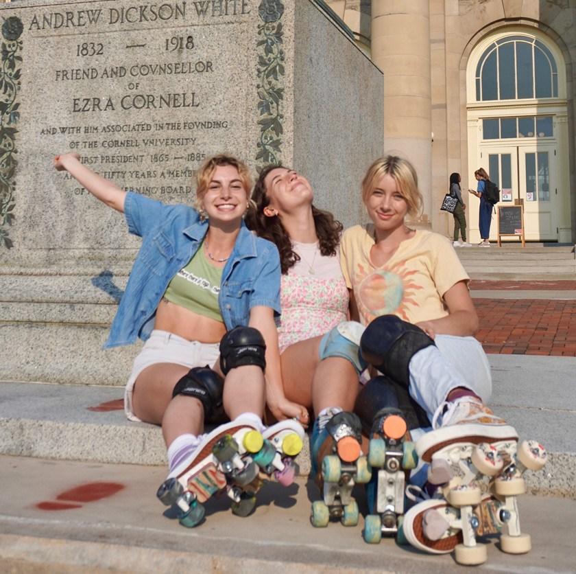 Nina Oleynikov '22, Ann Maris Walton '22, and Clara Matton '22 enjoy a sunny-day skate on the Arts Quad.